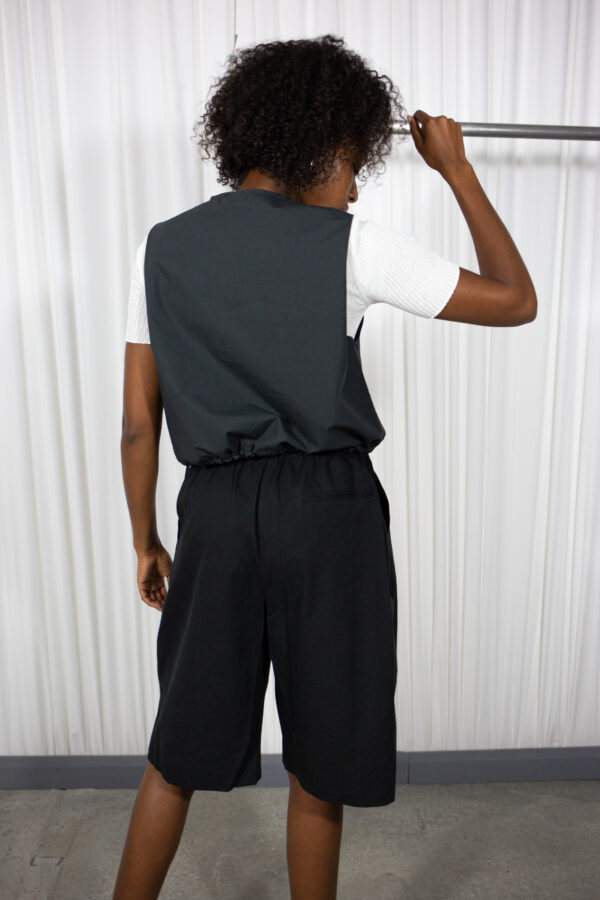 Lime Vest Dark Grey by Table